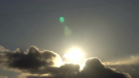 Beautiful cloudscape with large clouds and sunrise breaking through cloud mass. Stock Footage