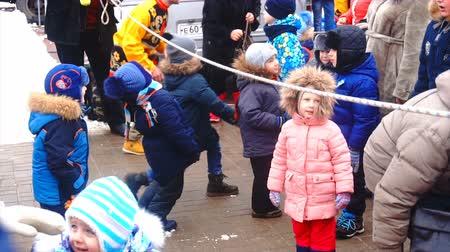 KURSK, RUSSIA- 18 FEBRUARY, 2018: Russian fun,the children run under the rope game on Shrove Tuesday.