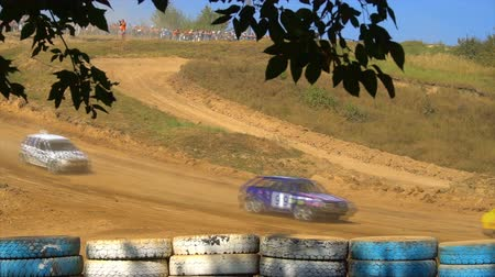 годовой : KURSK, RUSSIA - AUG 25: rally racing annual competition ,racers are driving through the sand