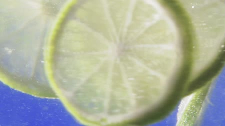 ice cube : mint and lime under water Stock Footage