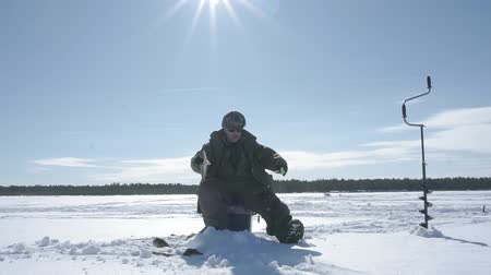 baars : fisherman catches a fish, winter sport, winter hobby Stockvideo