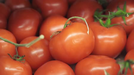emtia : red ripe tomatoes on the market counter