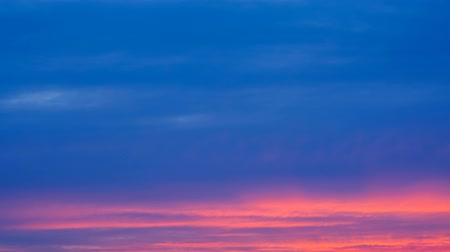 celestial : sunset sky. Flying clouds are blue pink orange colored clouds. 4 k. timelapse