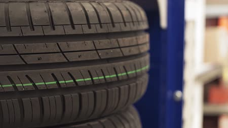 tread : rubber car tires in store retail Stock Footage