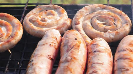 kiełbasa : bratwurst, fried sausages on the grill