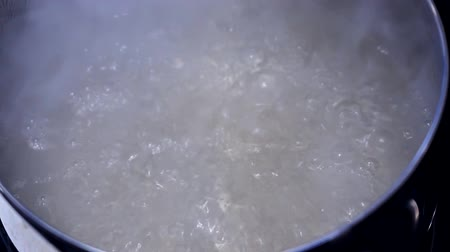 damp : boiling water close up in a pot