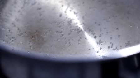 damp : boiling water close-up in a pot