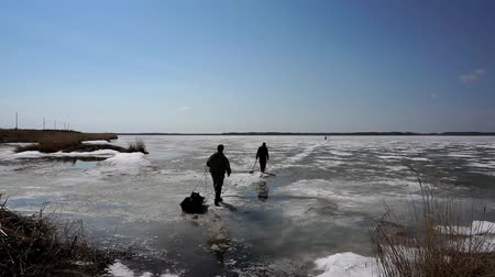fisher : men in winter come to the first ice for fishing