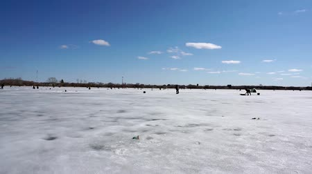 lanscape : lot of fishermen on the ice, winter sport ice fishing