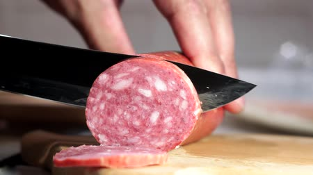 salame : cuts sausage with a knife close-up