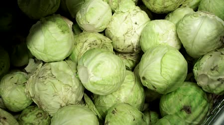 bakkal : sale of raw cabbage on the counter of a hypermarket