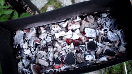 briquettes : BBQ Grill Pit With Glowing And Flaming Hot Charcoal Briquettes, Food Background Or Texture, Top View Stock Footage