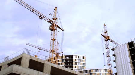 em desenvolvimento : Tower Cranes over residential buildings under construction. Construction of high-rise buildings
