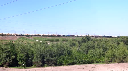 mozdony : moving train in the summer panorama. freight train transportation