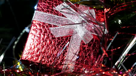 rotação : Christmas red gift box. Beautiful gifts under the tree. New years interior. Christmas tree, happy holidays. Christmas spirit, holidays and celebrations concept Vídeos