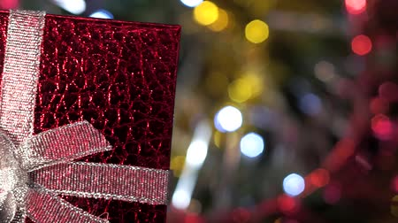 abend : Christmas gift in hand on Christmas background close up Videos