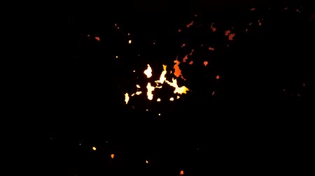 beczka : flashing fire on a black background, flames through a hole. Fire inside the iron texture