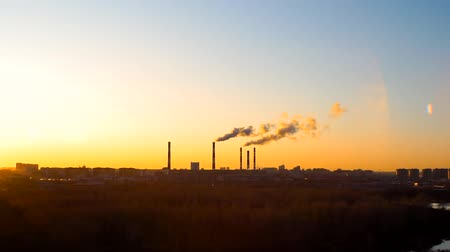 дымоход : smoke from the chimneys of the plant at sunset. The concept of environmental pollution