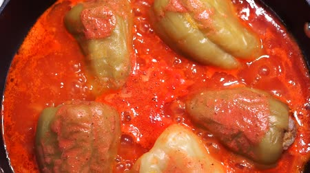 pimentas : stewed peppers in tomato sauce, close-up, top view. Boiling peppers cooking stuffed peppers
