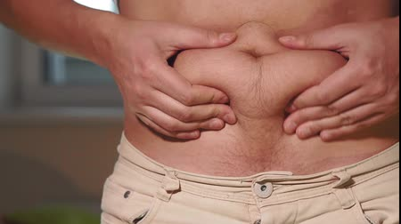 упитанность : Fat belly. Man with overweight abdomen. Weight loss concept. selective focus