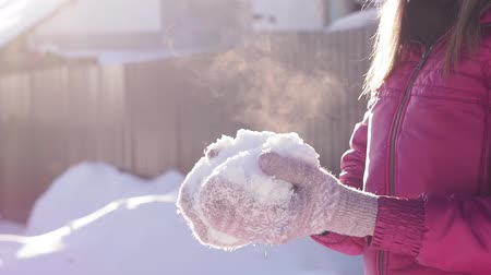 superb : woman throw up soft fresh snow, early winter time. winter vacation, winter, Sunny day. selective focus