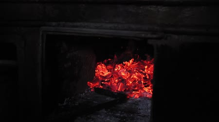 костер : coals in the furnace goes through. Russian stove, fireplace, selective focus Стоковые видеозаписи