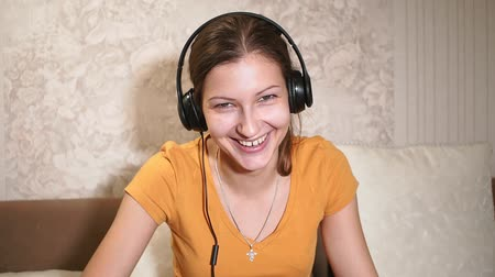 listening music : Beautiful Happy Girl Listens To Music Headphones. Wearing Headphones. Close Up. Home Leisure, Technology. Stock Footage