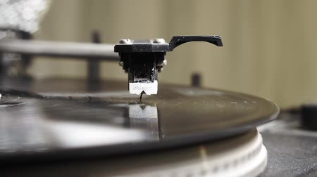 rock album : Turntable playing vinyl close up with needle on the record. close - up selective focus