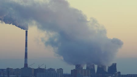 damp : environmental pollution. smoke from the pipes of factories close-up