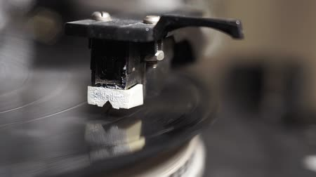 gramophone : vinyl record spinning. Wide shot close up of needle playing record album on a vintage turntable. Old school record player Stock Footage