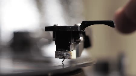 dyskoteka : close up image of old record player, retro filtered . selective focus. retro-style