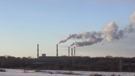 emissions : environmental pollution. smoke from factory chimneys. in winter, the plant CHP plant electricity steam Stock Footage