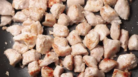 chicken recipes : cooking and grilling small cut up pieces of fried pork.