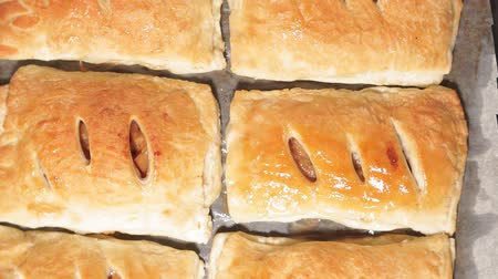pastelaria : baked buns with Apple and cinnamon ready-made dish close-up. the view from the top