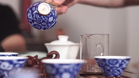 ceramika : Ritual Tea ceremony on the tea table.Water drops. Chinese ritual. Culture of Asia. selective focus, pours tea