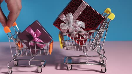 продавец : buying gifts in the online store. basket gift boxes and shop bags. shopping cart. The concept of shopping