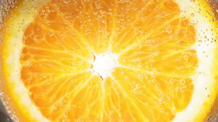 íz : Close-up of a drop water or juice ripe orange. fruit gives off freshness and juice. fruit for diet and healthy food concept Stock mozgókép