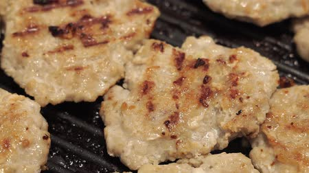 cielęcina : juicy homemade cutlets are cooked in a frying pan. In bubbling oil