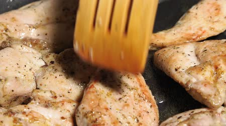 göğüs : Pieces of chicken fillet are slowly fried in an open pan close-up. food preparation Stok Video