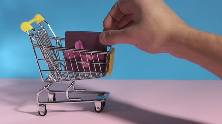 rabat : mini shopping cart hand puts gift. using as e-commerce, online shopping, and business marketing concept