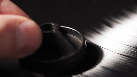gramophone : record from an old vintage turntable is spinning. removes dust from the record. close-up selective focus
