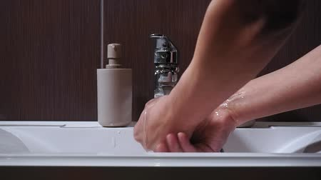 chróm : hygiene concept, a man washing hands in the bathroom close-up. Man washing male hand with soap and water under faucet Dostupné videozáznamy