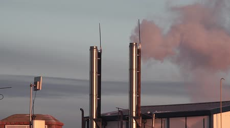 dünya çapında : smoke from the chimney of an old coal boiler goes into the air. Stok Video