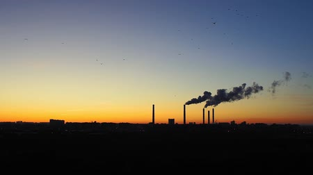 aquecimento global : factories smoke or steam into the atmosphere at sunset. concept of environmental pollution Stock Footage