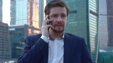 dismay : The Man Is Scared Of Talking On The Phone Stock Footage