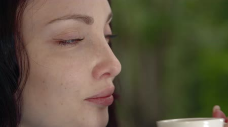 expectancy : Girl with a coffee close-up Stock Footage