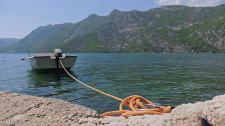 cordame : A boat tied to the shore. Stock Footage