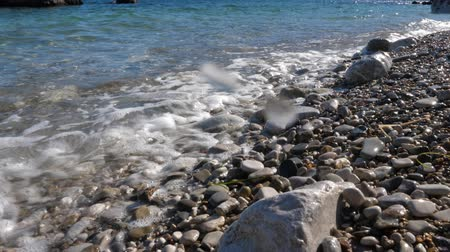 adriyatik : Waves washing pebbles