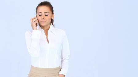 on the phone : Portrait of beautiful business woman talking cell phone Stock Footage