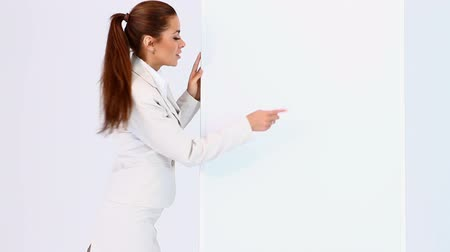 kopya : Sexy business woman pointing at blank board and showing thumb up